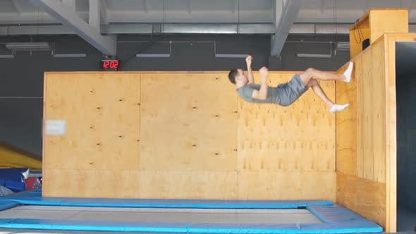 Thumbnail for Trampoline Jumper Performs Complex Acrobatic Exercises on the Trampoline