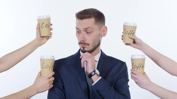 Thumbnail for Pensive Businessman Thinking about Coffee