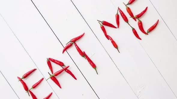 Thumbnail for A Words EAT ME Formed with Small Red Chilli Peppers