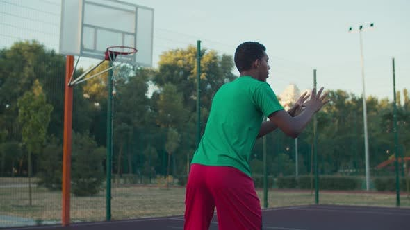 Basketball Player Shooting for Field Goals Outdoor