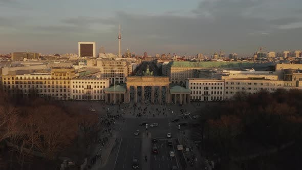 Thumbnail for AERIAL: Brandenburg Gate in Berlin with View on Alexanderplatz TV Tower in Beautiful Sunset Light