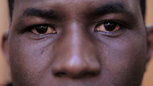 sad serious african american young man staring at camera- close up