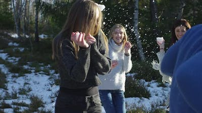 Women playing with snow