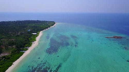 Wide angle birds eye island view of a summer white paradise sand beach and turquoise sea background