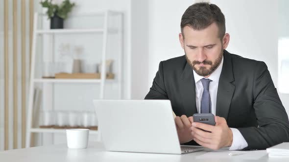 Thumbnail for Businessman Using Smartphone for Online Financial Trading