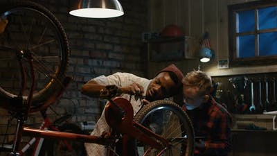 Man Teaches a Boy Bicycle Maintenance