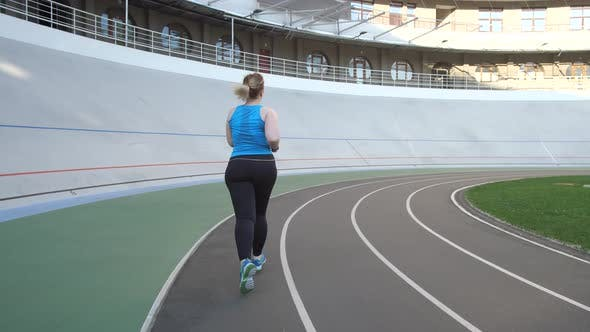 Thumbnail for Plus Size Woman During Morning Running on Track