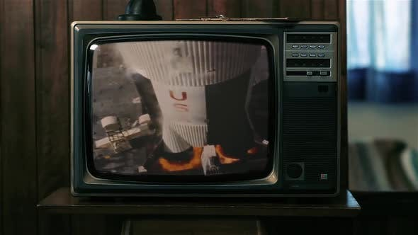 Cover Image for Apollo 11 Rocket Launch on a Retro TV.