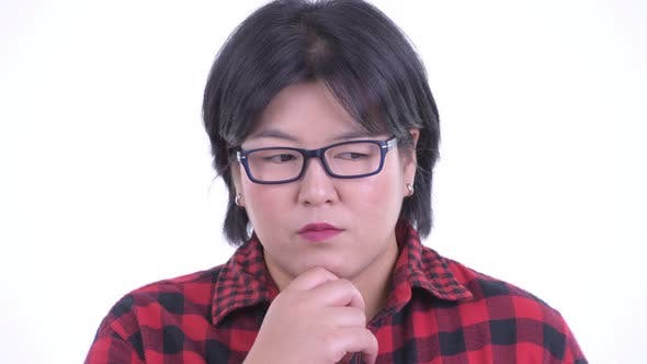 Thumbnail for Face of Stressed Overweight Asian Hipster Woman Thinking and Looking Down