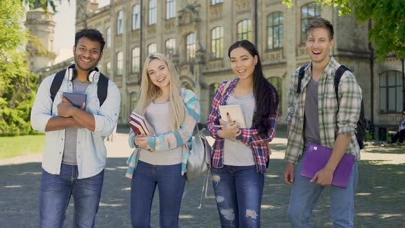 Cover Image for Mixed-Race Students Laughing Looking Into Camera, Standing on University Campus