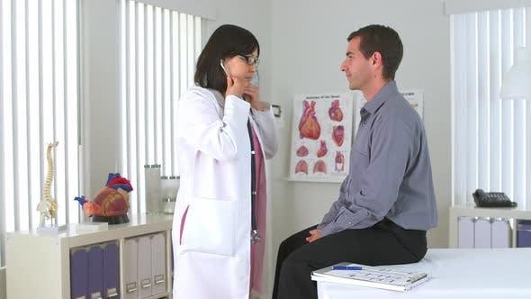 Thumbnail for Japanese doctor using stethoscope