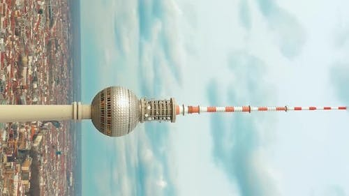 Vertical Video. Super Close Up View Circle Around the Alexanderplatz TV Tower in Berlin, Germany.