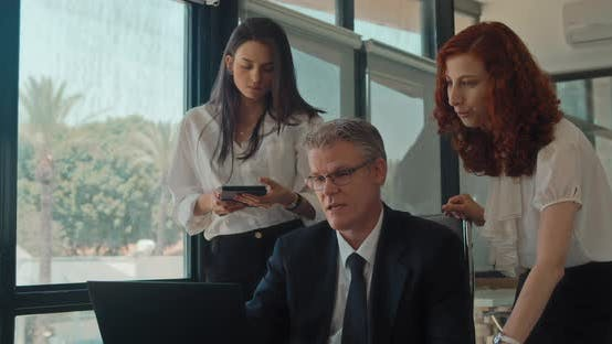 A businessman sharing his ideas with the rest of the team during a meeting, Slow motion