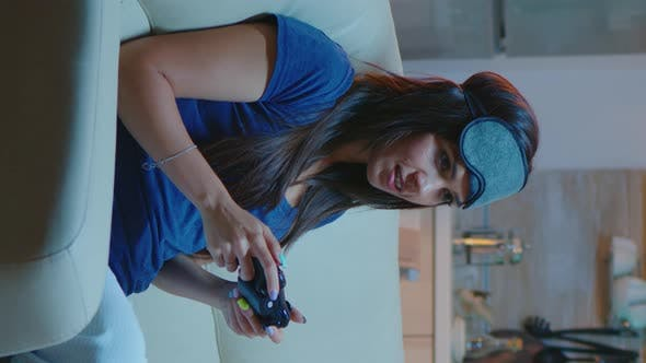 Thumbnail for Vertical Video: Determined Woman Playing Video Game