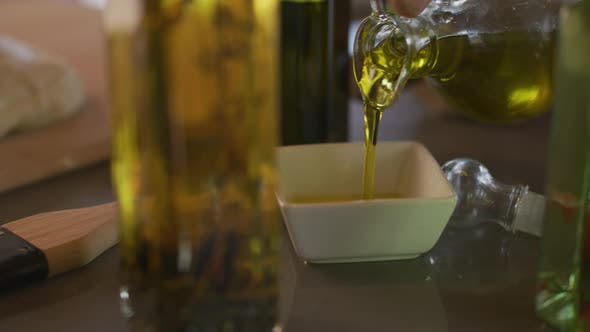 Thumbnail for Olive oil is poured into dish