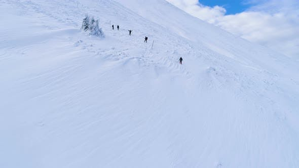 Thumbnail for Group Of Mountain Backpackers Walking On Snow