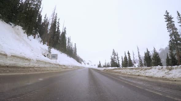 Time-lapse. POV point of view - Driving over Loveland Pass in the winter.
