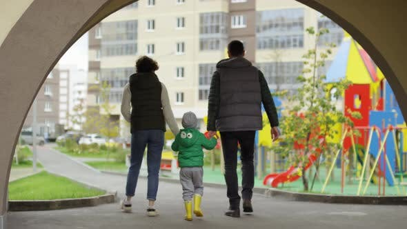 Thumbnail for Young Parents and Son Returning from Outdoor Walk