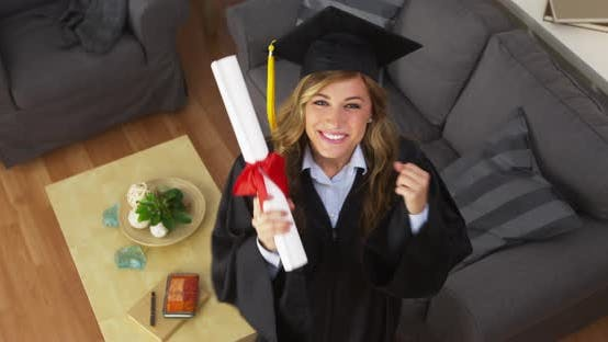 Thumbnail for Happy young woman graduate holding diploma