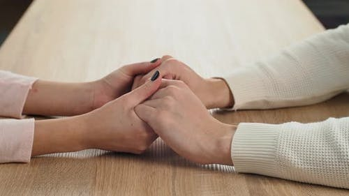 Close Up Affectionate Woman Holding Hands of Beloved Man Showing Love and Care