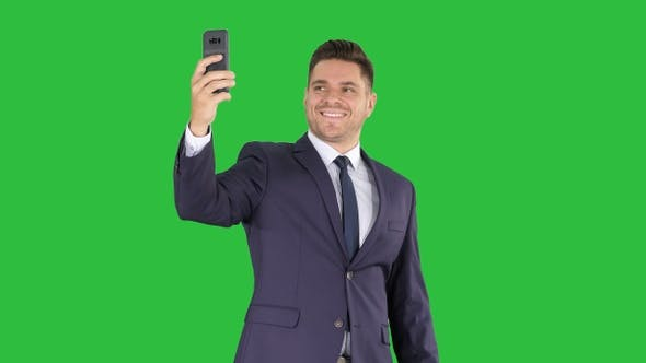 Thumbnail for Happy young handsome businessman recording vlog with his