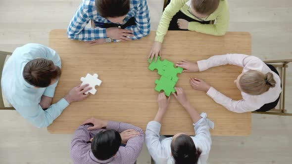 Thumbnail for Businesspeople assembling jigsaw puzzle