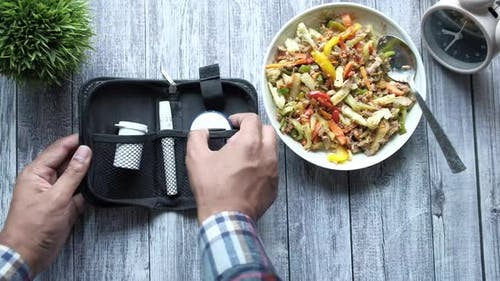 Diabetic Measurement Tools and Healthy Food Salad on Table