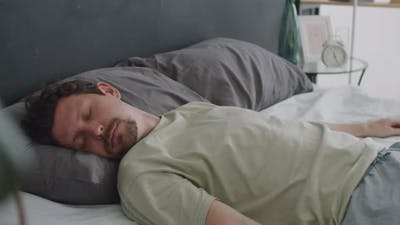 Man Falling on Bed and Sleeping