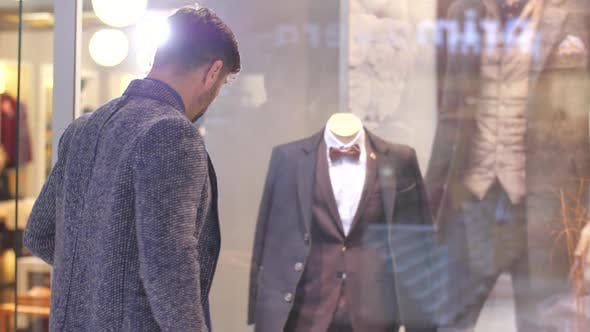 Thumbnail for Man Looking at Suit in a Shop Window