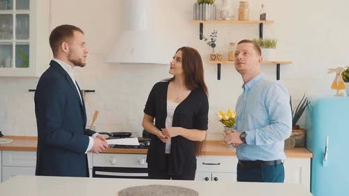 Realtor Shows the Kitchen