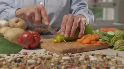 Cutting Vegetables Vegetarian Meal in Modern Home Kitchen