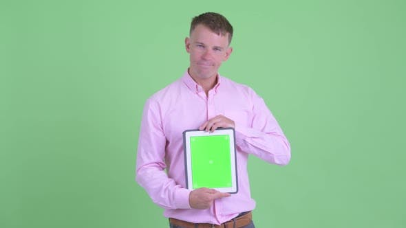 Thumbnail for Stressed Businessman Showing Digital Tablet and Getting Bad News