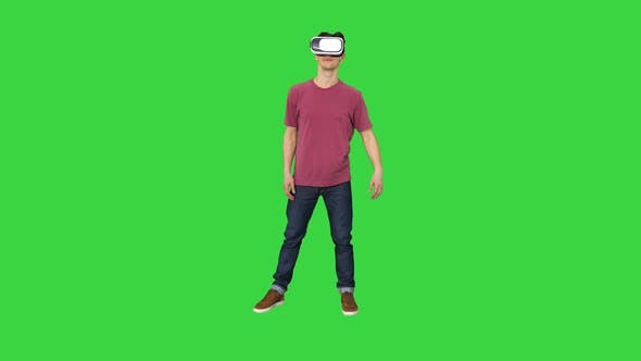 Thumbnail for Casual Man in VR Glasses Dancing Playing Video Game Beginners Level on a Green Screen, Chroma Key.