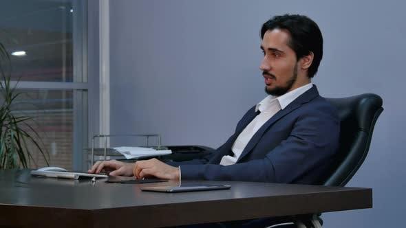 Portrait of Latin Businessman Sitting and Listening Carefully