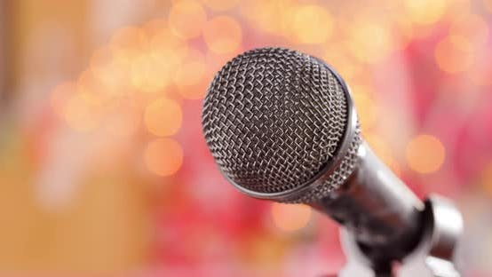Thumbnail for Microphone Stage Against Blurry Light Blurry Background