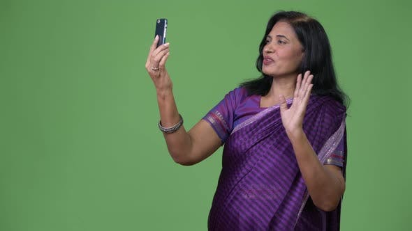 Thumbnail for Mature Happy Beautiful Indian Woman Video Calling Using Phone