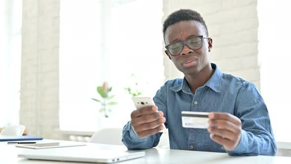 Thumbnail for Online Payment Failure on Phone by Young African Man