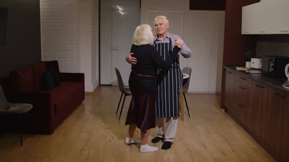 Thumbnail for Senior Couple in Love Have Romantic Evening, Dancing Together in Kitchen, Celebrating Anniversary