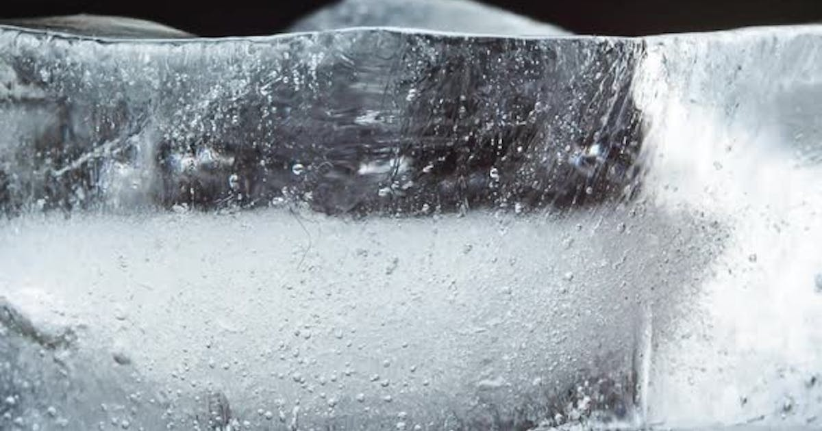 Ice Melts and Rotates on a Black Background