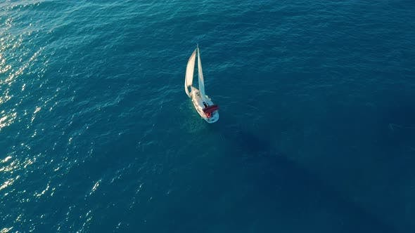 Thumbnail for Aerial View. Yacht Sailing on Open Sea at Sunny Day.