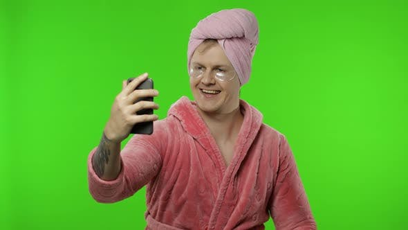 Thumbnail for Portrait of Transsexual Man in Bathrobe Using Mobile Phone for Video Call