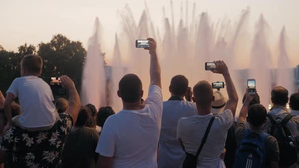 Thumbnail for Crowd Taking Pictures with Cell Phones, Fountains in Barcelona, Event. A Crowd Taking Pictures with