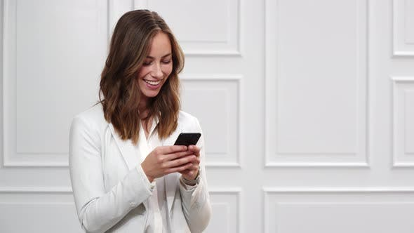 Thumbnail for Businesswoman Texting on Smartphone