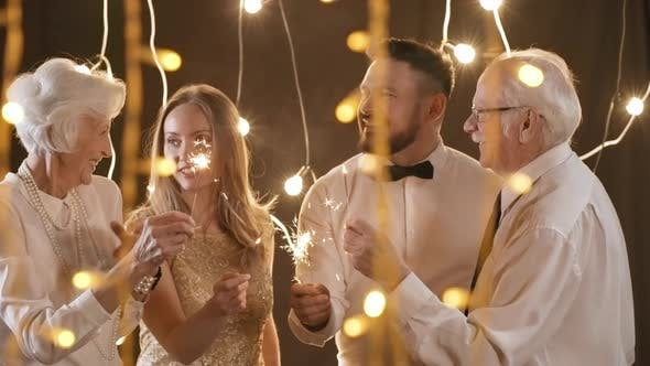 Thumbnail for Happy Family with Sparklers Celebrating Together