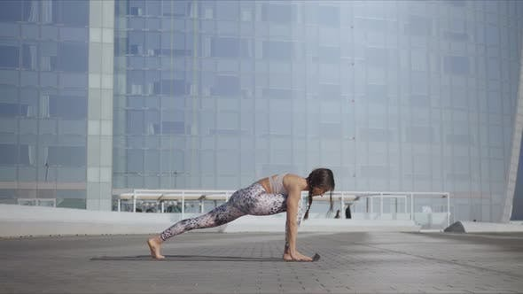 Thumbnail for Woman Standing in Warrior Pose at Street. Girl Practicing Yoga on City Street
