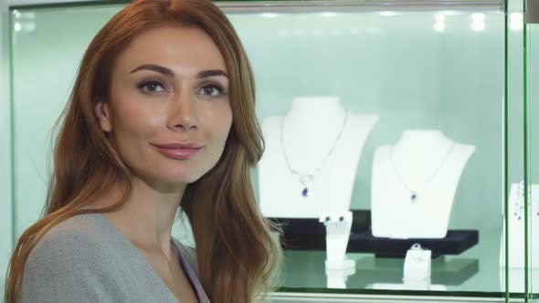Thumbnail for Sexy Beautiful Woman Smiling To the Camera at the Jewelry Store