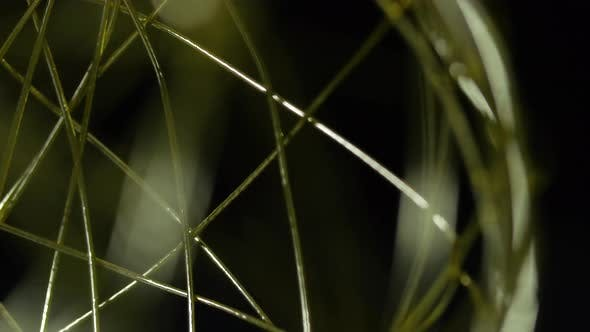 Thumbnail for Golden Wireframe Sphere Object Spinning Into Focus