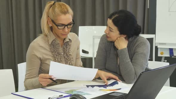 Thumbnail for Beautiful Mature Woman and Her Senior Business Colelague on a Meeting