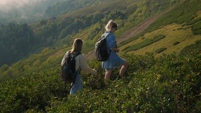 Two High School Girls is Traveling at Nature in Mountains