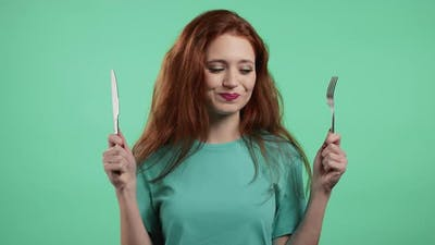 Portrait of Hungry Woman with Fork and Knife